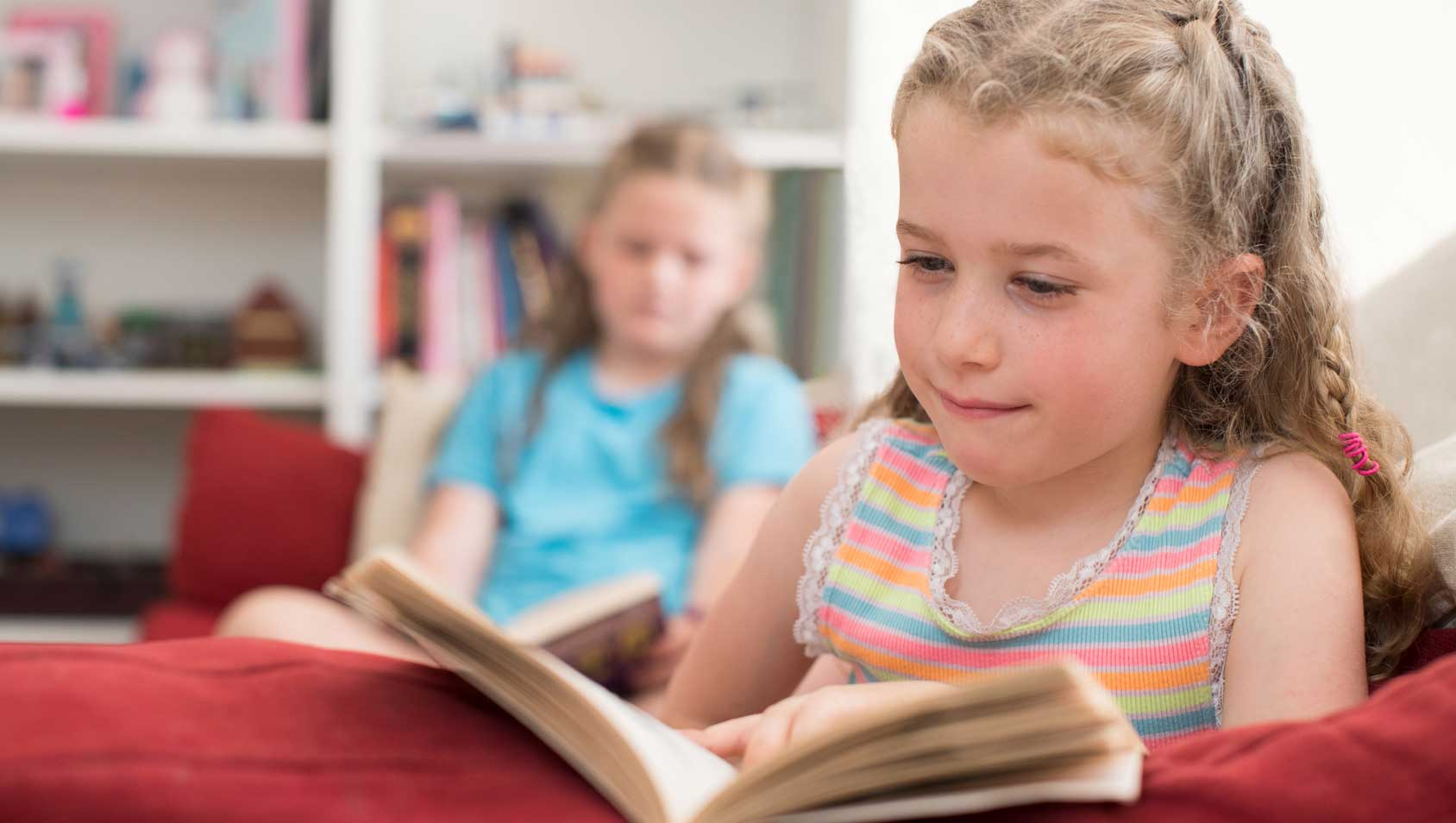 Girl reading a book, learning to read