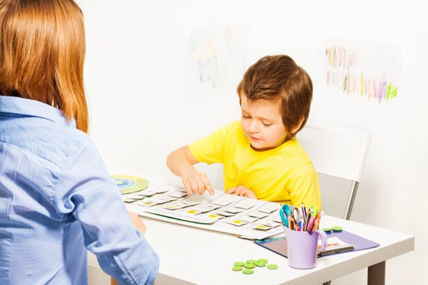 Boy plays in developing game pointing at calendar
