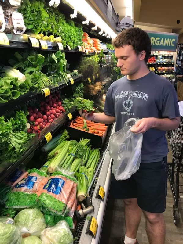 Jacob Exploring the Vegetables at the Grocery Store