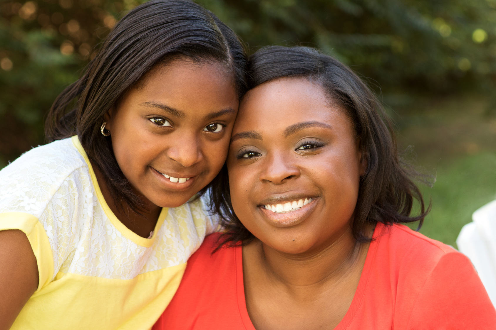 Portrait of an African American mother and her daughter.