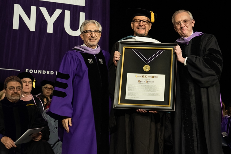 Presenting Marco Damiani, CEO of AHRC New York City, with the David B. Kriser Medal, are, Dr. Stuart Hirsch, left, Vice Dean for International Initiatives, and Dr. Charles N. Bertolami, right, Her-man Robert Fox Dean, NYU College of Dentistry