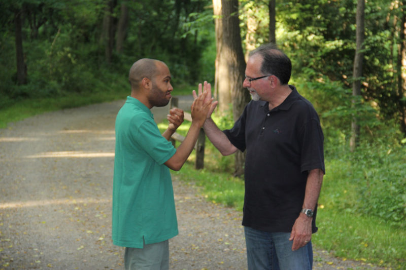 Tariq giving his dad, Dr. Robert Naseef, a high five