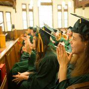 Soon to be Threshold graduates listening to graduation speakers (Photo courtesy of Lesley University)