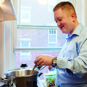 Transition Program student, Brian Hoyle, learning to cook in his own apartment (Photo courtesy of Lesley University)
