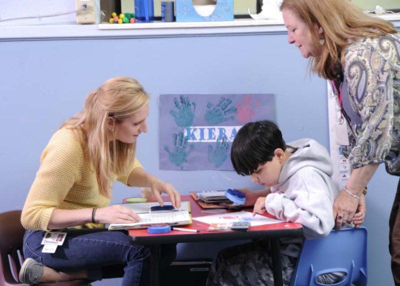 Child receiving instruction as part of PBIS Autism