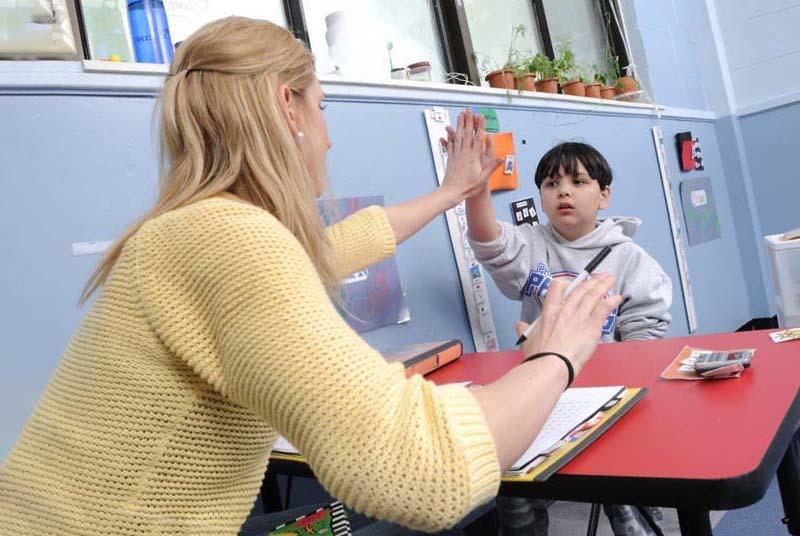 Teacher providing positive feedback following a correct response
