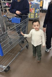 Holding onto the shopping cart