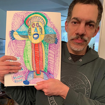 Elvin Flores with one of his pieces