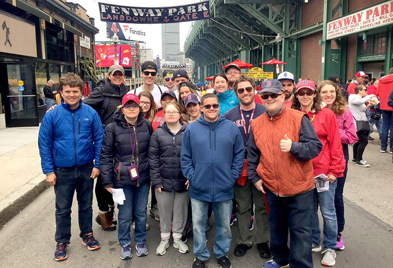 Threshold students, staff and alumni enjoying a Red Sox game at Fenway Park. They are able to choose among several special events offered at Threshold each week.