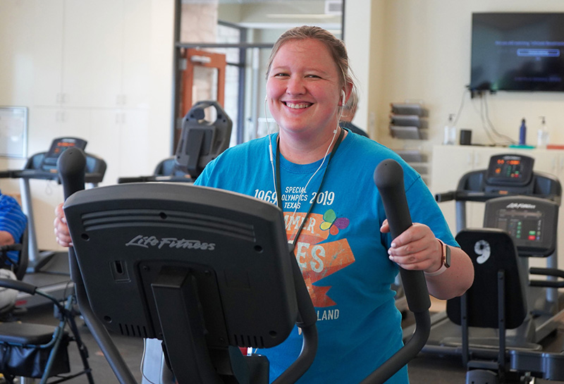 A resident of Marbridge in Manchaca, Texas enjoys a workout. Fitness centers are a key amenity for attracting prospective residents.