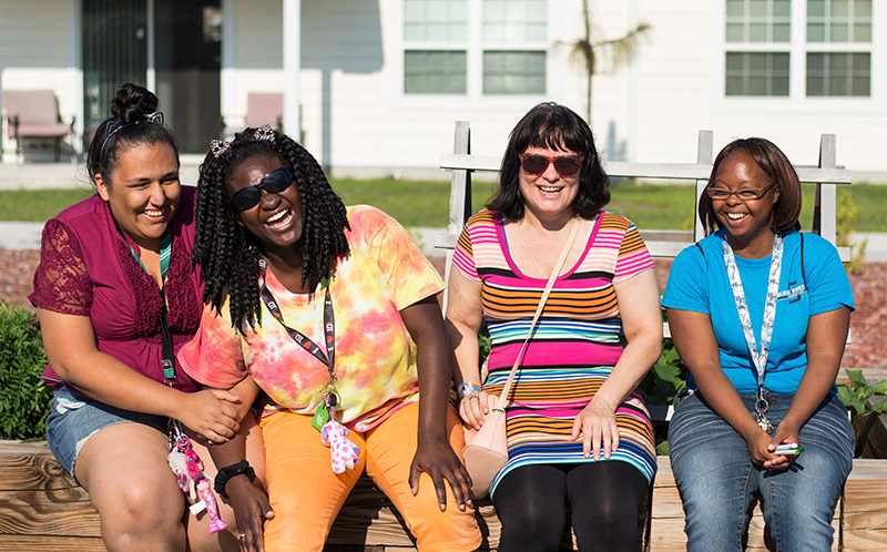 Residents of The Arc Jacksonville Village, one of various national properties listed in the Housing Market Guide, enjoying new friendships