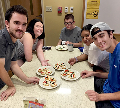 Threshold second-year students proudly display the appetizers they've created in their Food Lab class. In this class students learn basic nutrition, recipe comprehension and food preparation. Their favorite part of class is tasting!
