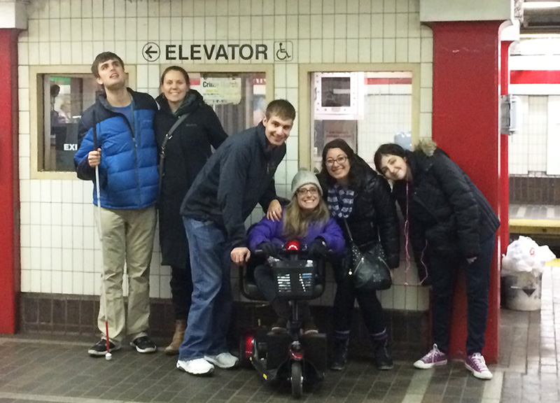 Threshold students and alumni regularly travel on public transportation to activities and events. Staff utilize these trips as opportunities to offer travel training. Here they pose at Park Street MBTA station in Boston.