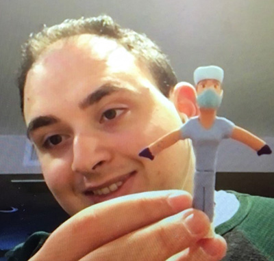 Tom Gambaro, of Brooklyn, with one of the hospital staff figurines he molded out of clay