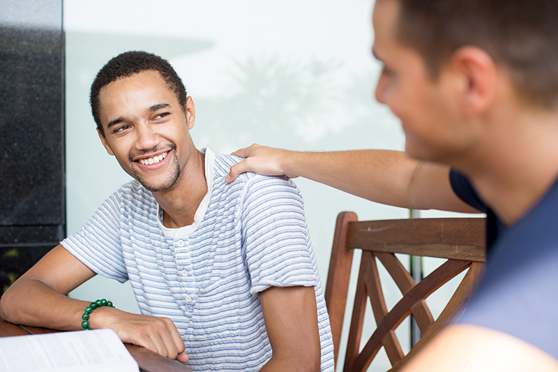 smiling young man receiving support