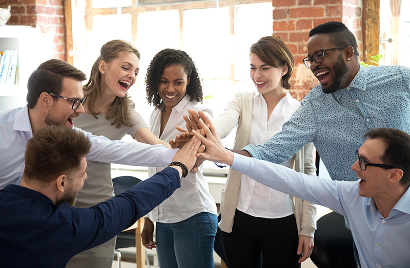 Happy diverse colleagues celebrate great teamwork