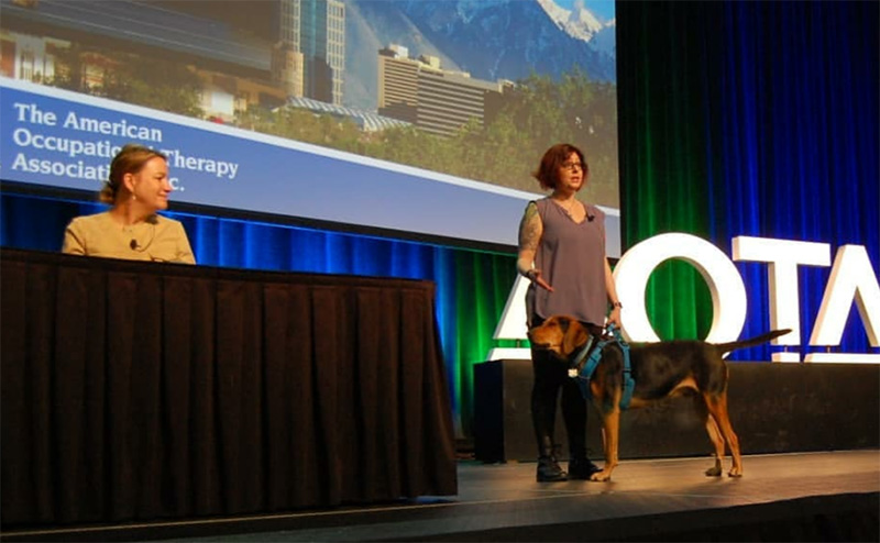 Becca presents on adult autism supports with her Emotional Support Animal, Walter, at the Association of Occupational Therapy's National Conference.